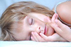 Sleeping little girl Stock Photos