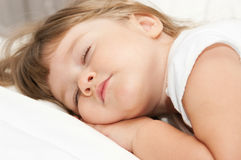 Sleeping little girl Stock Photo
