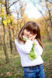 Sleeping little girl in the autumn forest Stock Images