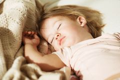 Sleeping little girl. Carefree sleep little baby with a soft toy Royalty Free Stock Image