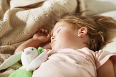 Sleeping little girl. Carefree sleep little baby with a soft toy Royalty Free Stock Photo