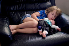 Sleeping little girl with doll royalty free stock images