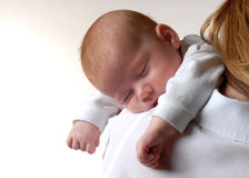 Sleeping little wonder. Baby sleeping on mami`s shoulder Royalty Free Stock Photography