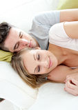 Sleeping lovers having fun together on a sofa Royalty Free Stock Photos