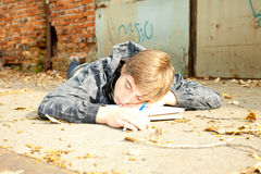 Sleeping male student. Learning in the park Royalty Free Stock Photography