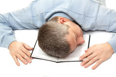 Sleeping man. Isolated man sleeping on book Stock Images