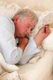 Sleeping man. Vintage photo of an elderly man sleeping Royalty Free Stock Image