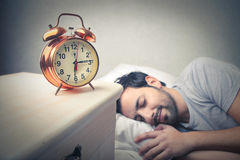 Sleeping man into bed Stock Photography