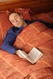 Sleeping man with book Stock Image