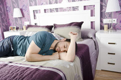 Sleeping man with clothes Royalty Free Stock Image