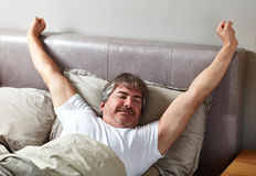 Sleeping man. Handsome caucasian man sleeping in his bed Stock Photography