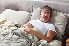 Sleeping man. Handsome caucasian man sleeping in his bed Stock Photos