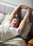 Sleeping man. Handsome caucasian man sleeping in his bed Royalty Free Stock Photography