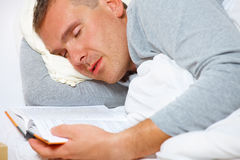 Sleeping man with open book Stock Photography