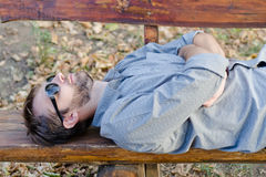 Sleeping man with sunglasses Royalty Free Stock Photos