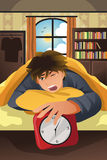 Sleeping man turning off alarm Royalty Free Stock Image