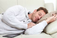 Sleeping man. Sleeping young handsome man in cozy apartment Royalty Free Stock Photo