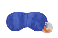 Sleeping mask and earplugs. Blue sleeping mask and a pair of orange earplugs Royalty Free Stock Images