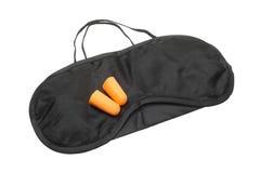 Sleeping mask and earplugs Stock Photo