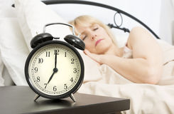 Sleeping In: Middle Age Woman Sleeping Past Seven Stock Photography