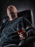 Sleeping middle aged alcoholic and wine glass Stock Photo