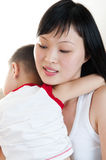Sleeping on mommy´s sholder. Royalty Free Stock Photos