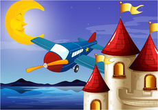 A sleeping moon, an airplane and a castle Royalty Free Stock Photography