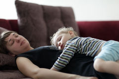 Sleeping mother and child Stock Photos
