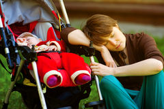 Sleeping mother and her child Stock Image