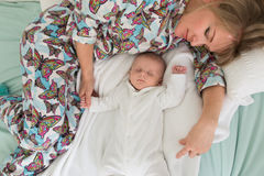 Sleeping mother and two months old baby boy Royalty Free Stock Photos