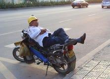 Sleeping on the motorcycle Stock Image