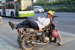 Sleeping on the motorcycle Royalty Free Stock Photo