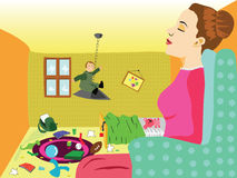 Sleeping nanny. Nanny is sleeping in the armchair while the kid is making a mess Stock Photography