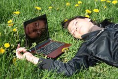 Sleeping near laptop Royalty Free Stock Photos