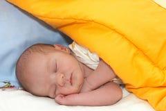 Sleeping newborn. In his first days Stock Photos