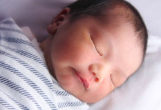 Sleeping newborn. A sleepy three day old baby. Soft focus Stock Photo