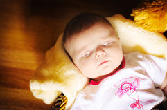 Sleeping newborn baby stock images