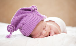 Sleeping  newborn baby (at the age of 14 days). Newborn baby (at the age of 14 days) sleeps in a knitted  hat Royalty Free Stock Photos