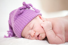 Sleeping  newborn baby (at the age of 14 days). Newborn baby (at the age of 14 days) sleeps in a knitted  hat Royalty Free Stock Photo