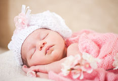 Sleeping  newborn baby (at the age of 14 days). Newborn baby (at the age of 14 days) sleeps in a knitted  hat Royalty Free Stock Images