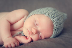 Sleeping newborn baby. On a blanket Stock Photography