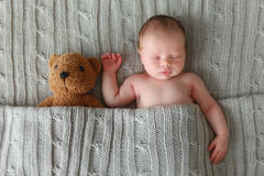 Sleeping newborn baby Stock Images