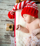 Sleeping newborn baby in christmas decorations Royalty Free Stock Photo