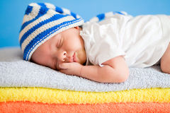 Sleeping newborn baby on colorful towels Stock Photo
