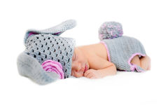 Sleeping newborn baby dresses Easter bunny. Royalty Free Stock Images