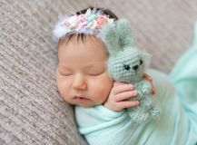 Sleeping newborn baby girl Stock Photo
