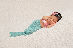 Sleeping Newborn Baby Girl in a Mermaid Costume Royalty Free Stock Photos