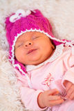 Sleeping newborn baby girl Stock Photography