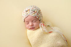 Sleeping Newborn Baby Girl Swaddled in Yellow Stock Photography