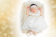 Sleeping newborn baby girl wearing white dress Stock Photos